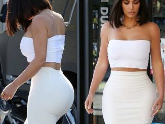Kim K flashes her incredible hourglass figure as she steps out in strapless crop top and bodycon skirt (Photos)