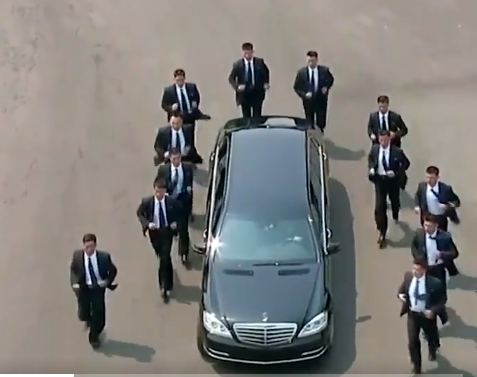 This video of Kim Jong Un driving off and his 12 bodyguards running beside the vehicle is the best thing you'll see on the internet today