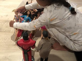 North West plays with her dad, Kanye's doll (photos)