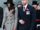 Meghan Markle and Prince Harry look sombre as they sing hymns at dawn service commemorating Anzac Day in London