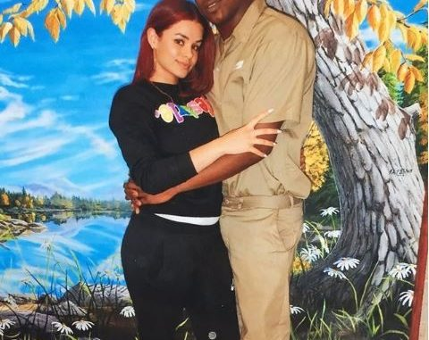 Loyal woman goes viral after sharing loved-up photo with her jailed lover in his prison uniform