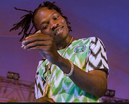'Stupid b!tch who's your baby?' - Naira Marley drag fans who called him illiterate on Twitter